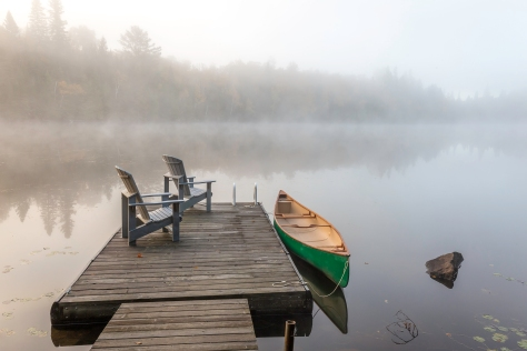 Green Canoe and Dock on a Misty Morning
