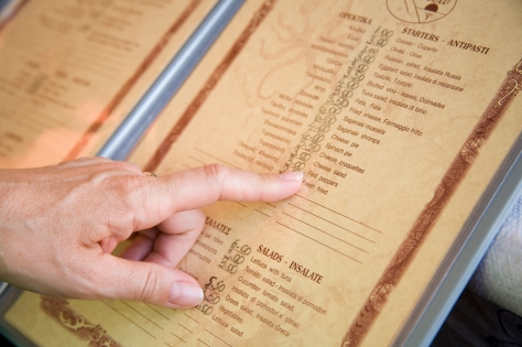 finger on a menu