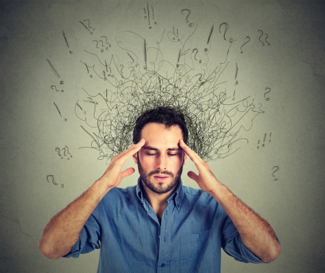 man with stressed face expression brain melting into lines